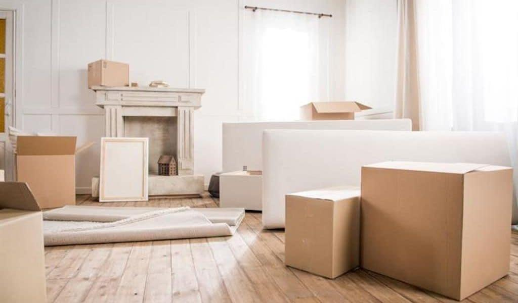 Several cardboard boxes litter the floor of an almost-packed apartment