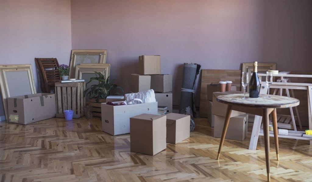 Tables, chairs, boxes and more stacked on a beautiful parquet floor