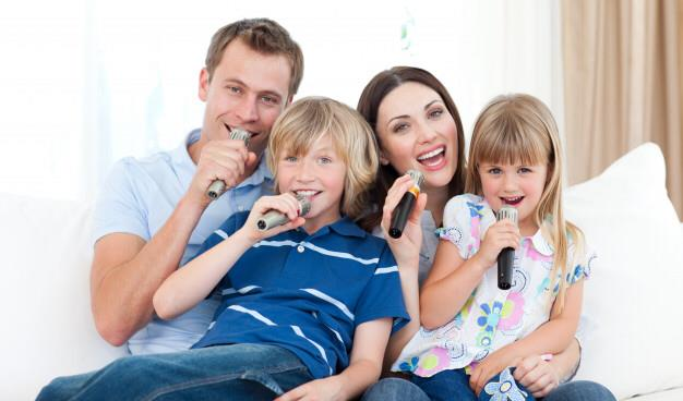 Family sing with microphones