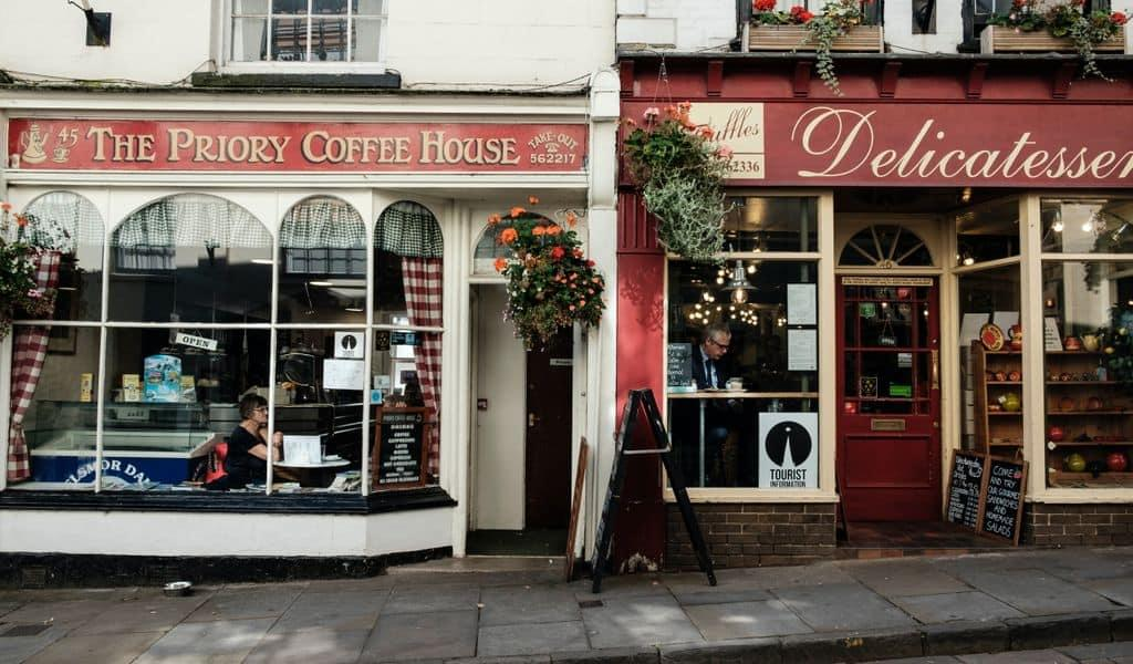 One coffee house sits next to a small-town delicatessen
