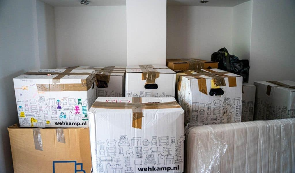 A stack of boxes in a diminutive Tennessee room