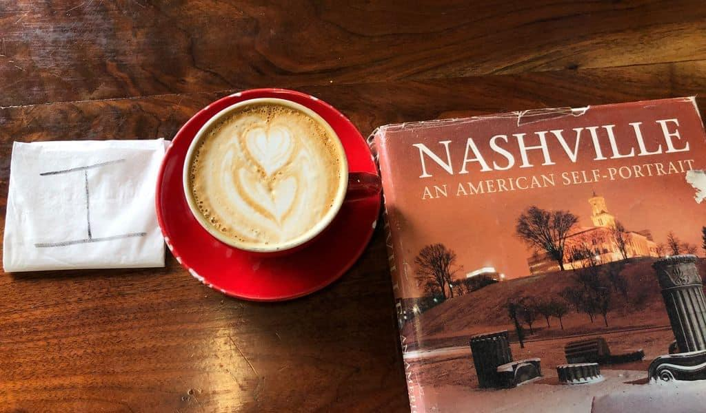 A cappuccino heart helps spell the phrase 'I love Nashville' on a hardwood table