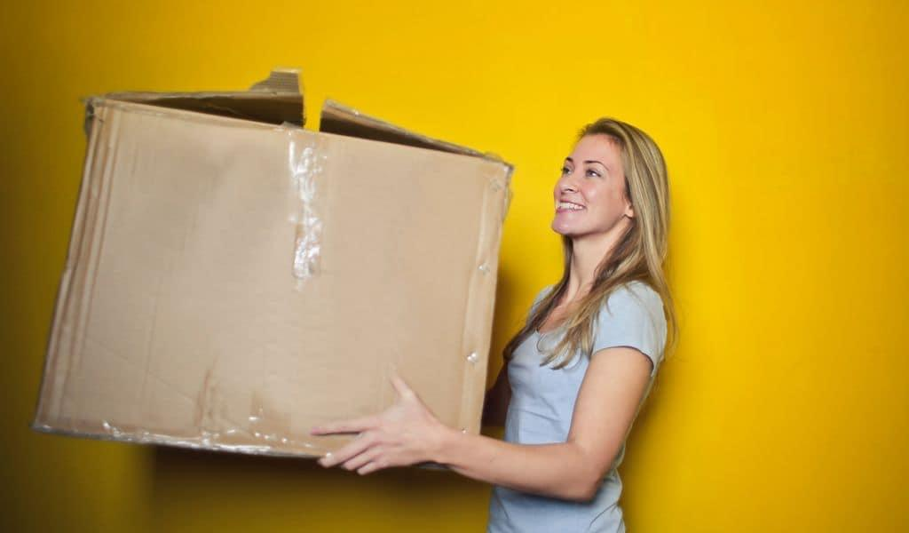 Woman holding a box for packing