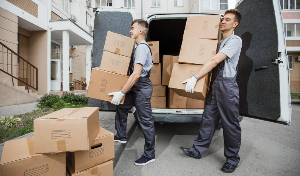 A moving crew unloading packed boxes