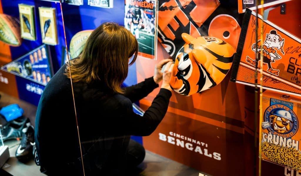 A fan admiring a Bengals sign in Cincinnati