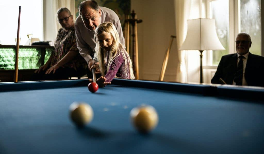 Family playing pool