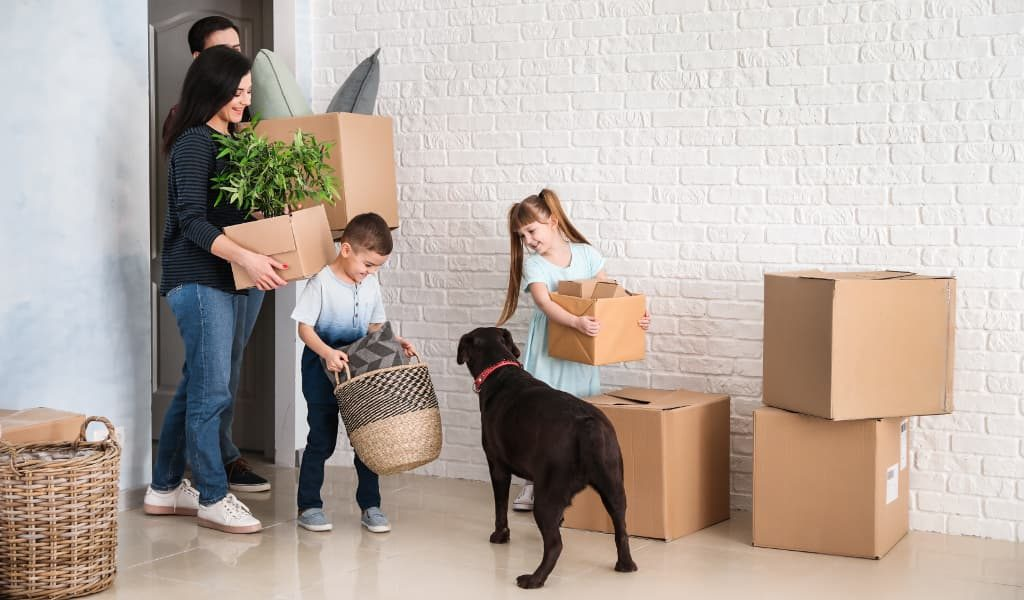 Family packing together with a pet dog