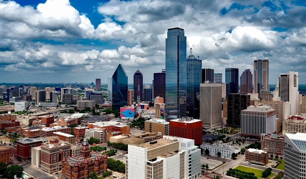 High rise buildings in Dallas with clouds overhead