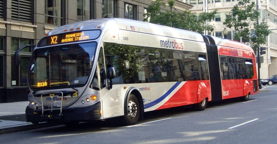 A Metro Bus in Washington red and white in colour