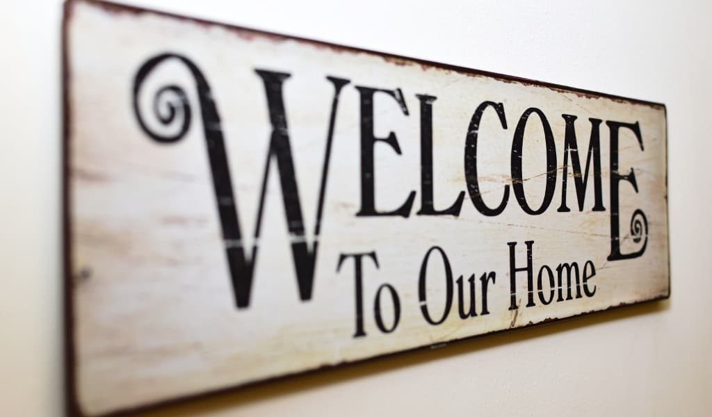 Off-white 'Welcome to our home' wooden sign