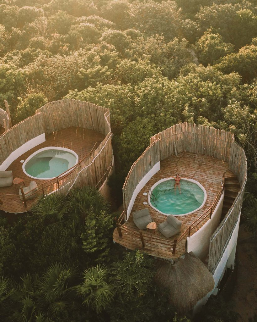 two teal hot tubs with luxurious wooden surroundings, as seen from above