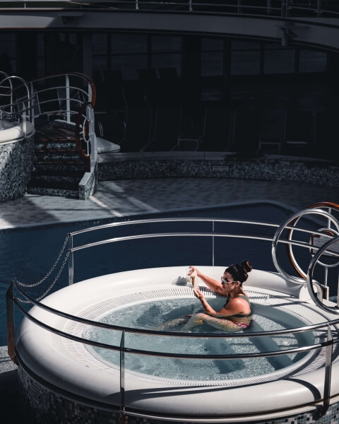 Woman relaxing in a white industrial hot tub