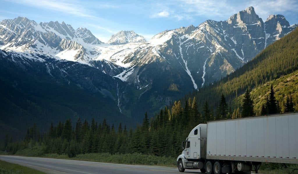 Moving truck travelling through mountainous area